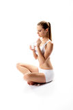 Woman eating yogurt. Young woman eating yogurt on white background Royalty Free Stock Photos
