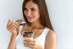 Woman Eating Yogurt, Berries And Oatmeal For Healthy Breakfast Stock Image