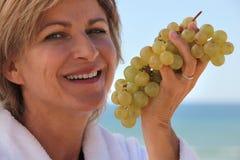 Woman eatinggrapes Royalty Free Stock Photos