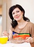 Woman eats buckwheat Royalty Free Stock Photography