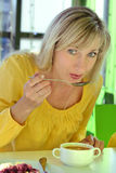 The woman eats in cafe Stock Photography