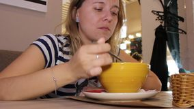 Woman eats in a cafe stock footage