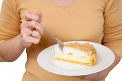 Woman eats cheesecake Royalty Free Stock Photography