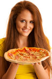 Woman eats delicious pizza isolated over white background Royalty Free Stock Photos