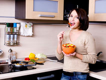 Woman eats the fresh vegetables Royalty Free Stock Photo