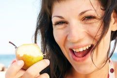 Woman eats fruit stock photography