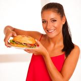 Woman eats hamburger isolated over white background Royalty Free Stock Photography