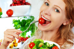 Woman eats healthy food vegetable vegetarian salad about refrige Royalty Free Stock Photos