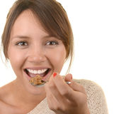 Woman Eats her cereal Royalty Free Stock Images