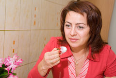 A woman eats an ice-cream. With a strawberry stock images