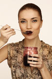 Woman eats jam Stock Photos