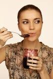 Woman eats jam Royalty Free Stock Image
