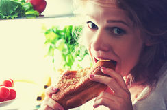 Woman eats night stole the refrigerator Stock Photography