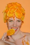 Woman eats orange Royalty Free Stock Images