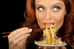 Woman Eats pasta Stock Photo