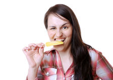Woman eats a popsicle Royalty Free Stock Photos