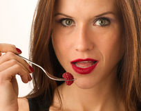Woman eats RAW fruit Red Raspberry Food Stock Photography
