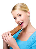 Woman eats the sweet black chocolate Stock Image
