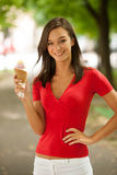 Woman eats sweet ice cream outdoor in park Stock Photography