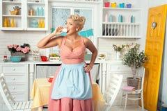 Woman eats sweets. Royalty Free Stock Image