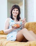 Woman eats tomatoes salad Stock Photos