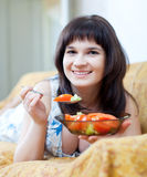 Woman eats tomatoes salad royalty free stock photos