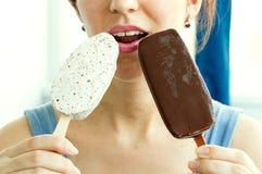 Woman eats two different ice cream ice cream Stock Photo