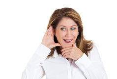Woman eavesdropping Royalty Free Stock Photo