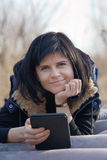 Woman with ebook Stock Image