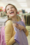Woman Ecstatically Shopping for Clothes Royalty Free Stock Photo