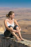 A young woman on the background of the desert Royalty Free Stock Photo