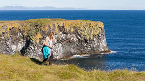Woman on the edge of the cliff - Iceland Royalty Free Stock Photography