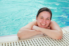 Woman at the edge of a swimming pool Royalty Free Stock Image
