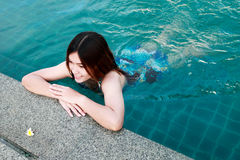 Woman at the Edge of Swimming Pool Royalty Free Stock Photo
