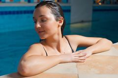Woman at the edge of a swimming pool Royalty Free Stock Images