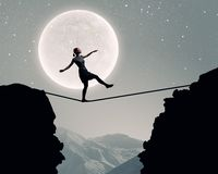 Woman on edge Stock Images