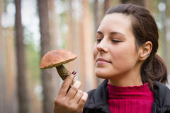 Woman with edible mushroom in the forest Royalty Free Stock Photography