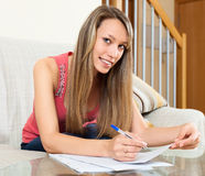 Woman editing  documents at table Royalty Free Stock Photo