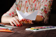 Woman educate origami. Do ship fron paper sheet Stock Images