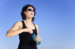 Woman after effort with water bottle Royalty Free Stock Image