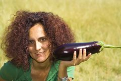 Woman with eggplant. Pretty redhead woman holding eggplant Royalty Free Stock Photo