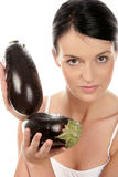 Woman with eggplants. Portrait of young woman holding eggplants isolated on white background royalty free stock photo