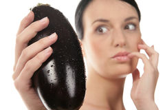 Woman with eggplants Stock Photos