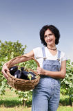 Woman with eggplants Stock Photography