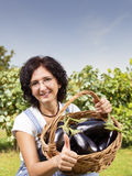Woman showing vegetables eggplants Stock Photo