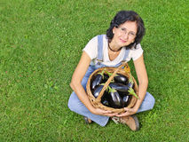 Woman with eggplants left copy-space Stock Photography