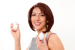 Woman with eggs Stock Photo