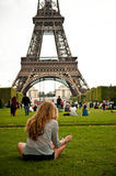 Woman in Eiffel Tower in Paris Stock Photos