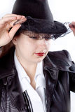Woman eith black coat and hat Stock Images
