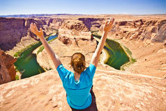 Woman Ejoying View at Horseshoe bend. A woman sits near the edge of the cliff at horseshoe bend in arizona Stock Images